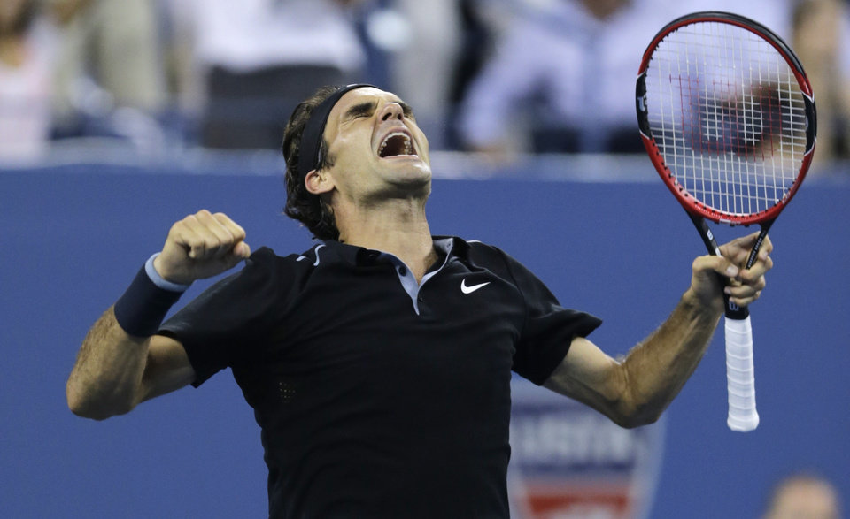 Photo - Roger Federer, of Switzerland, celebrates his win over Gael Monfils, of France, during the quarterfinal round of the 2014 U.S. Open tennis tournament, Thursday, Sept. 4, 2014, in New York. Federer defeated Monfils 4-6, 3-6, 6-4, 7-5, 6-2. (AP Photo/Charles Krupa)