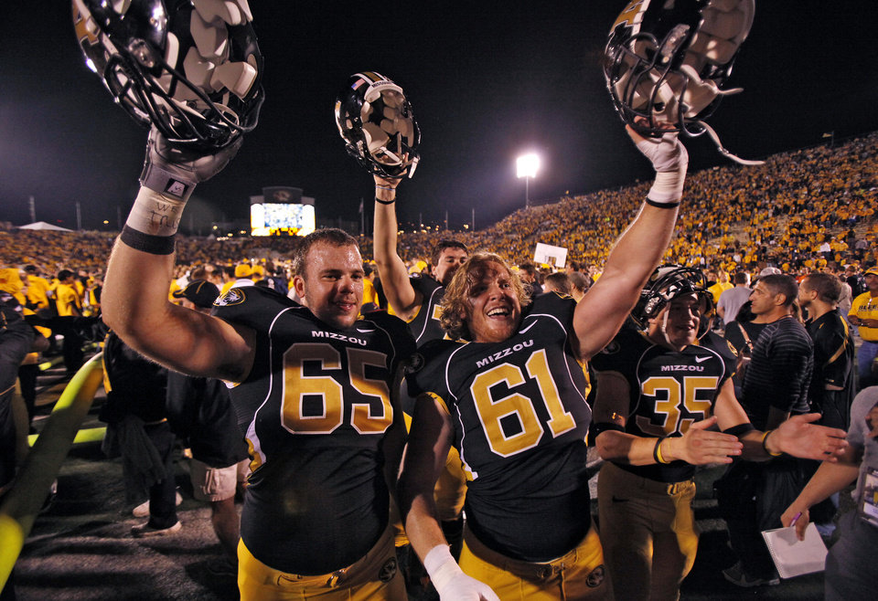 Missouri's Mitch Morse (65) and Max Copeland (61) celebrate after the college football game between the University of Oklahoma Sooners (OU) and the University of Missouri Tigers (MU) on Saturday, Oct. 23, 2010, in Columbia, Mo. Oklahoma lost the game 36-27. Photo by Chris Landsberger, The Oklahoman