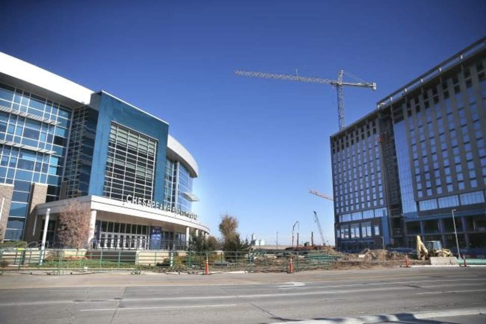 Photo -  Chesapeake Energy Arena, left, is shown next to the new convention center under construction in downtown Oklahoma City.  [Sarah Phipps/The Oklahoman]