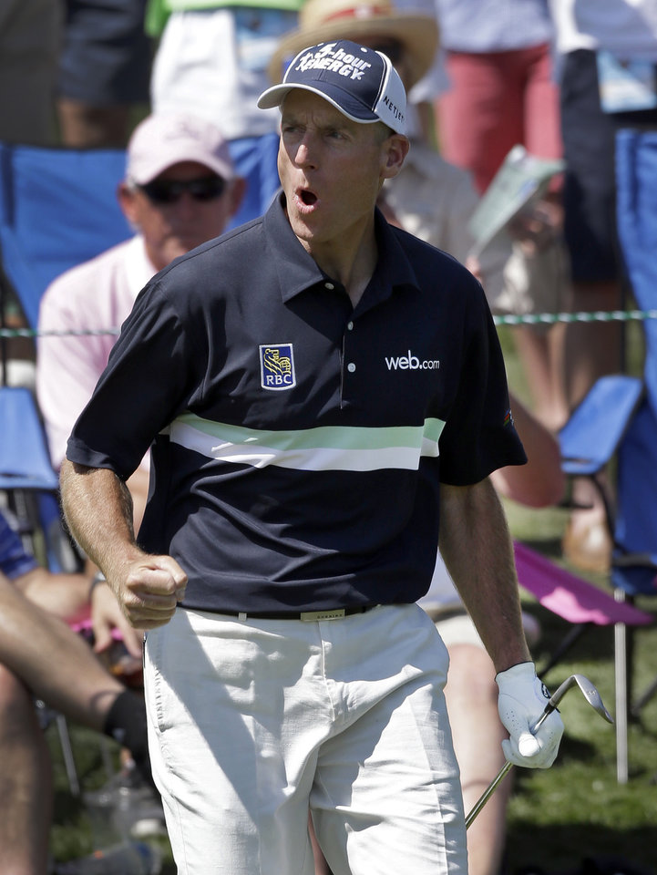 Photo - Jim Furyk reacts after chipping in for an eagle on the 15th hole during the final round of the Wells Fargo Championship golf tournament in Charlotte, N.C., Sunday, May 4, 2014. (AP Photo/Bob Leverone)
