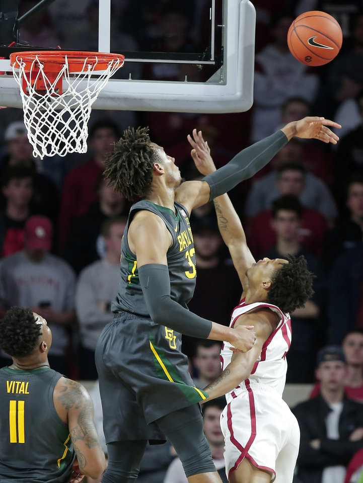 Photo - Baylor's Freddie Gillespie (33) blocks the shot of Oklahoma's Alondes Williams (15) during a men's NCAA basketball game between the University of Oklahoma Sooners (OU) and the Baylor Bears at the Lloyd Noble Center in Norman, Okla., Tuesday, Feb. 18, 2020. [Bryan Terry/The Oklahoman]