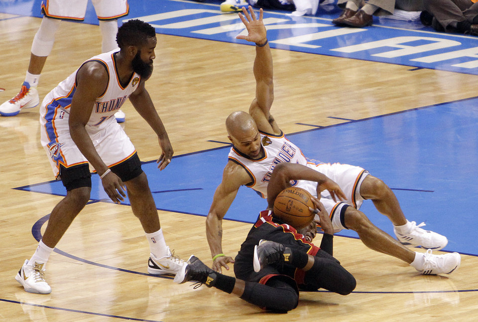 Oklahoma City's Derek Fisher (37) and Oklahoma City's James Harden (13) got after a loose ball with Miami's Dwyane Wade (3) during Game 2 of the NBA Finals between the Oklahoma City Thunder and the Miami Heat at Chesapeake Energy Arena in Oklahoma City, Thursday, June 14, 2012. Photo by Chris Landsberger, The Oklahoman