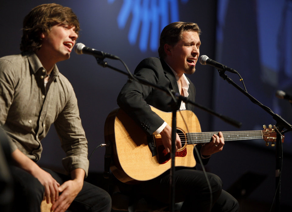 Photo - Zac, at left, and Isaac Hanson perform during a dinner for the Creativity World Forum at the National Cowboy and Western Heritage Museum on Tuesday, Nov. 16, 2010.  Photo by Bryan Terry, The Oklahoman