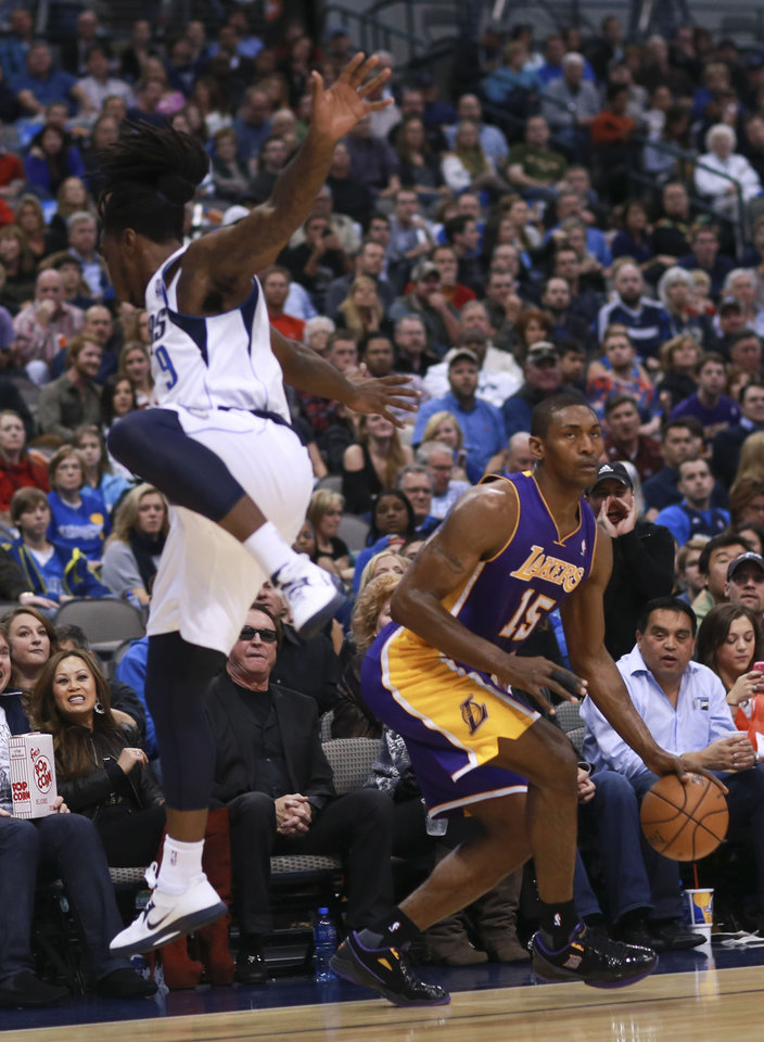 Photo -   Dallas Mavericks small forward Jae Crowder (9) leaps in an attempt to stop Los Angeles Lakers' Metta World Peace during the first half of an NBA basketball game on Saturday, Nov. 24, 2012, in Dallas. (AP Photo/Michael Mulvey)