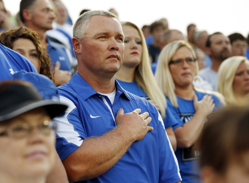 Guthrie head coach Rafe Watkins stands for the national anthem before a high school football game between Guthrie and Guymon at Jelsma Stadium in Guthrie, Okla., Friday, Sept. 21, 2012. Watkins has watched the last 8 games from the stands as he served a suspension dating back to last year. Photo by Nate Billings, The Oklahoman