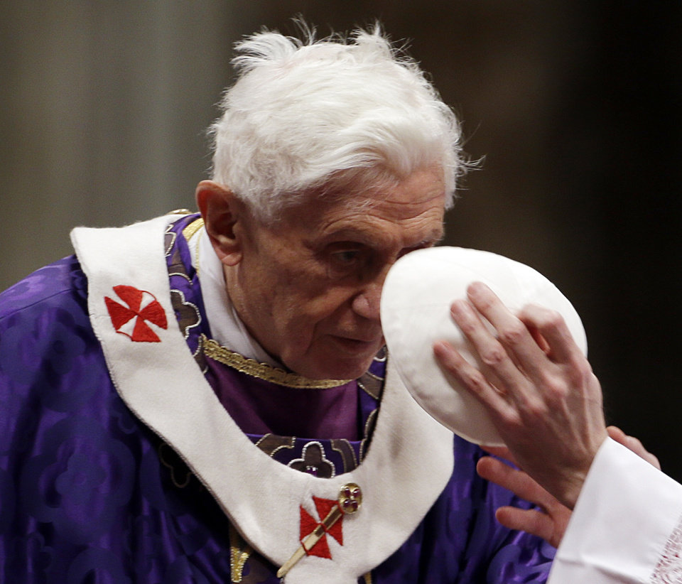 Bishop Guido Marini holds Pope Benedict XVI's skull cap during the Ash Wednesday mass in St. Peter's Basilica at the Vatican, Wednesday, Feb. 13, 2013.  Ash Wednesday marks the beginning of Lent, a solemn period of 40 days of prayer and self-denial leading up to Easter. (AP Photo/Gregorio Borgia)