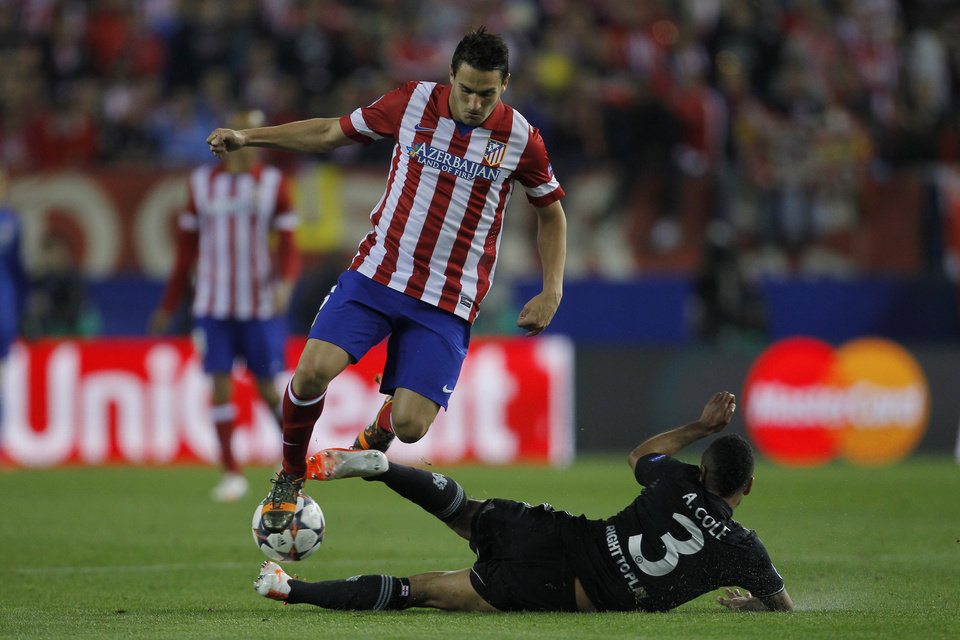 Photo - Atletico's Koke, left, in action with Chelsea's Ashley Cole during the Champions League semifinal first leg soccer match between Atletico Madrid and Chelsea at the Vicente Calderon stadium in Madrid, Spain, Tuesday April 22, 2014. (AP Photo/Gabriel Pecot)