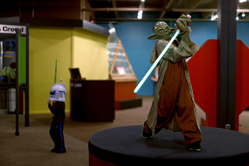 Logan Hunt, 11, of Oklahoma City, greets others as they enter Science Museum Oklahoma for the Bright Night of Star Wars sleepover. Photo by Bryan Terry, The Oklahoman <strong>Bryan Terry - THE OKLAHOMAN</strong>