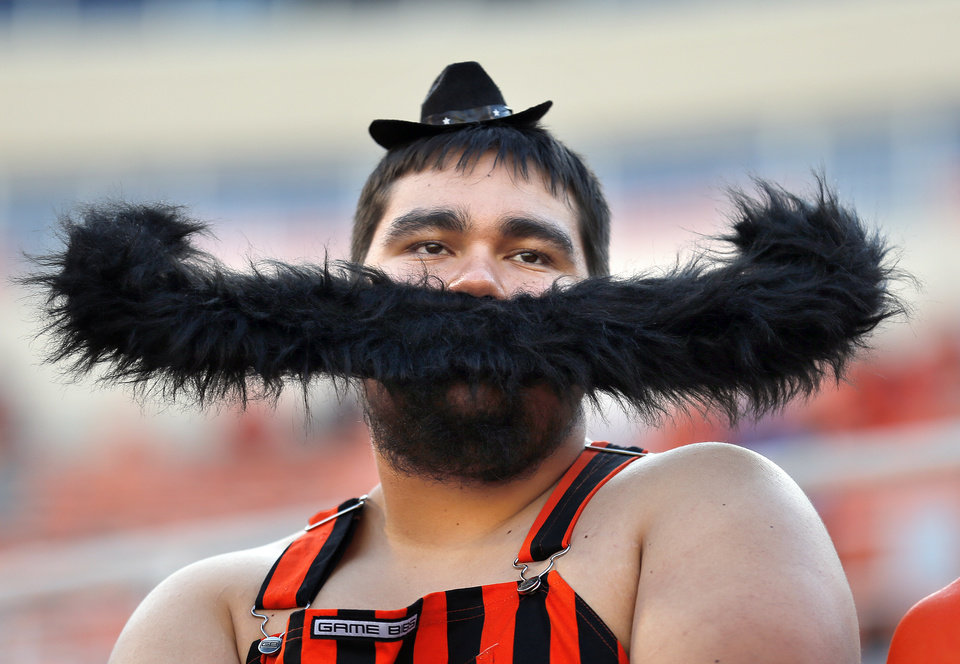 Photo - Smokey Solis watch the Cowboys warm up before the college football game between the Oklahoma State Cowboys (OSU) and the Central Arkansas Bears at Boone Pickens Stadium in Stillwater, Okla., Saturday, Sept. 12, 2015. Photo by Sarah Phipps, The Oklahoman