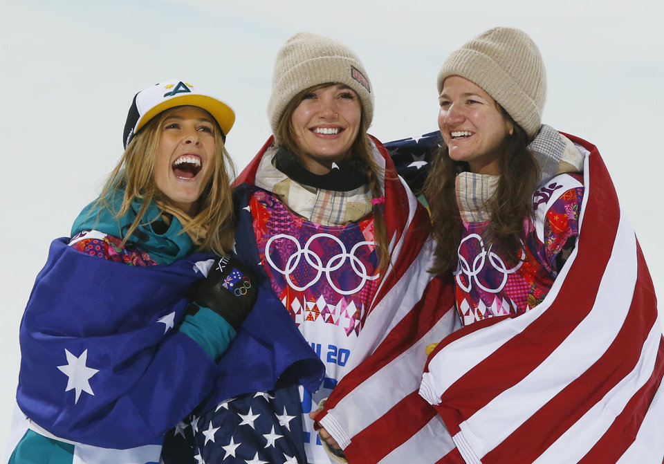 Photo - From left, silver medalist Australia's Torah Bright, gold medalist United States' Kaitlyn Farrington and bronze medalist United States' Kelly Clark pose following the women's snowboard halfpipe at the Rosa Khutor Extreme Park, at the 2014 Winter Olympics, Wednesday, Feb. 12, 2014, in Krasnaya Polyana, Russia. (AP Photo/Sergei Grits)