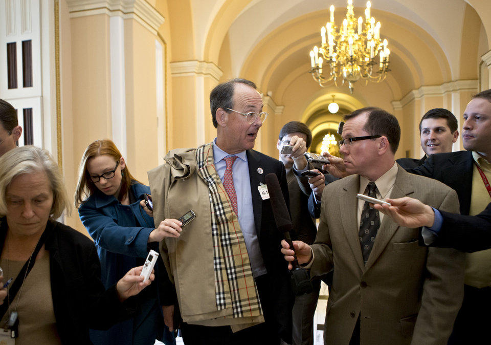 Former White House Chief of Staff Erskine Bowles, co-chair of the National Commission on Fiscal Responsibility and Reform, is pursued by reporters on Capitol Hill in Washington, Wednesday, Nov. 28, 2012, following a closed-door meeting House Speaker John Boehner of Ohio. (AP Photo/J. Scott Applewhite)