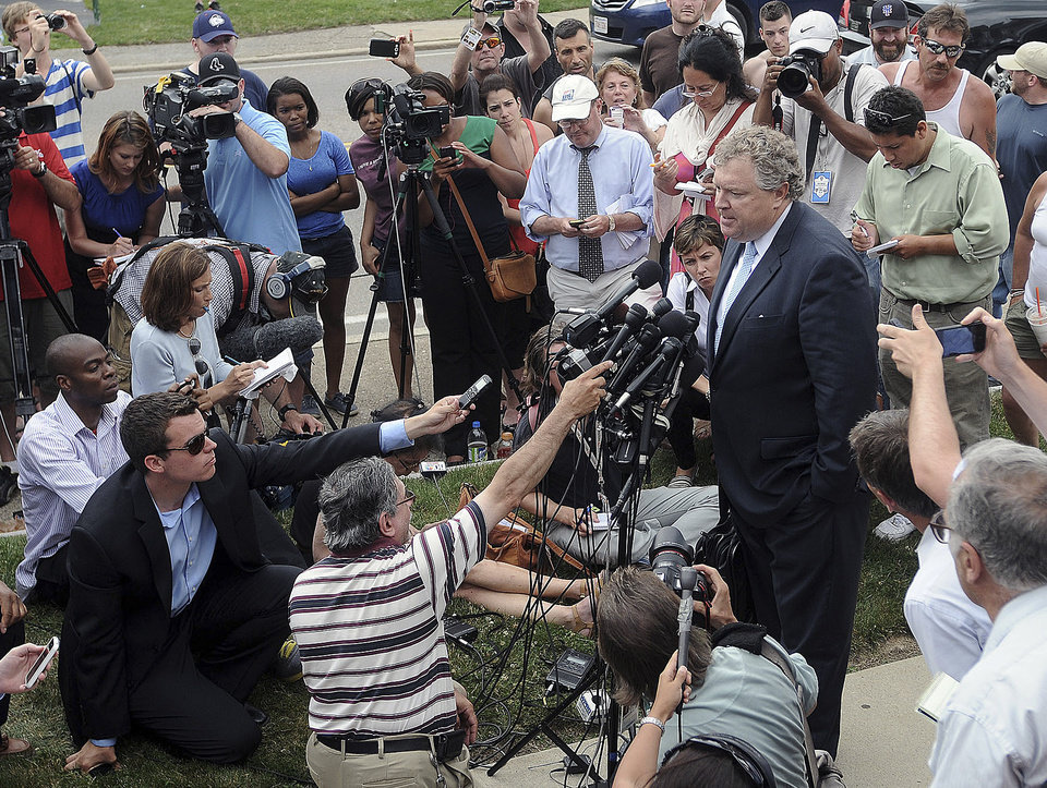 Photo - Michael Fee, defense attorney for former New England Patriots tight end Aaron Hernandez, speaks to the media outside Attleboro District Court after Hernandez was arraigned Wednesday, June 26, 2013, in Attleboro, Mass. Hernandez was charged with murdering Odin Lloyd, a 27-year-old semi-pro football player for the Boston Bandits, whose body was found June 17 in an industrial park in North Attleborough, Mass.   (AP Photo/The Sun Chronicle, Mark Stockwell)  MANDATORY CREDIT  MAGS OUT  PROVIDENCE JOURNAL OUT