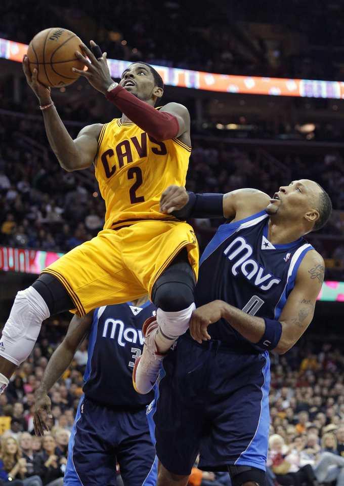 Cleveland Cavaliers' Kyrie Irving (2) shoots against Dallas Mavericks' Shawn Marion in the fourth quarter of an NBA basketball game on Saturday, Nov. 17, 2012, in Cleveland. Irving scored 26 points in the 103-95 loss to Dallas. (AP Photo/Mark Duncan)