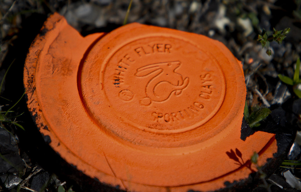 The remains of a shot sporting clay during the CASA fly shooting event at Silverleaf Shotgun Sports on Monday, April 23, 2012, in Guthrie, Oklahoma.  Brustad will carry 168 pounds in his pack as he runs that marathon. Photo by Chris Landsberger, The Oklahoman