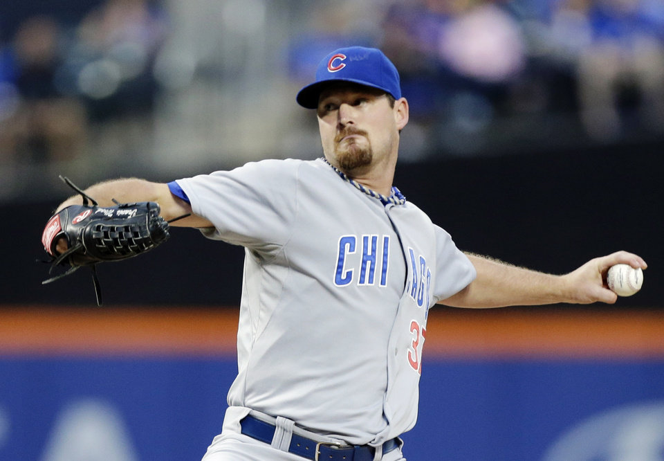 Photo - Chicago Cubs' Travis Wood delivers a pitch during the first inning of a baseball game against the New York Mets, Friday, Aug. 15, 2014, in New York. (AP Photo/Frank Franklin II)
