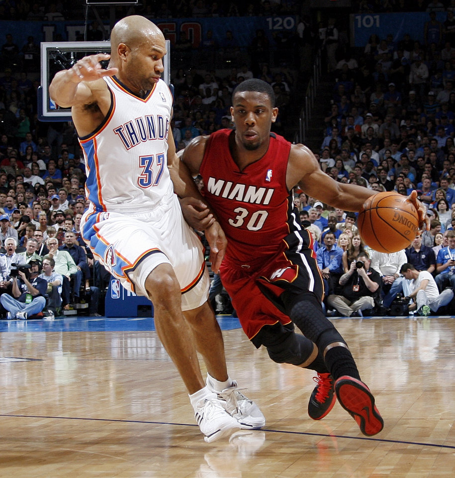 Miami's Norris Cole (30) drives the ball on Oklahoma City's Derek Fisher (37) during the NBA basketball game between the Miami Heat and the Oklahoma City Thunder at Chesapeake Energy Arena in Oklahoma City, Sunday, March 25, 2012. Photo by Nate Billings, The Oklahoman
