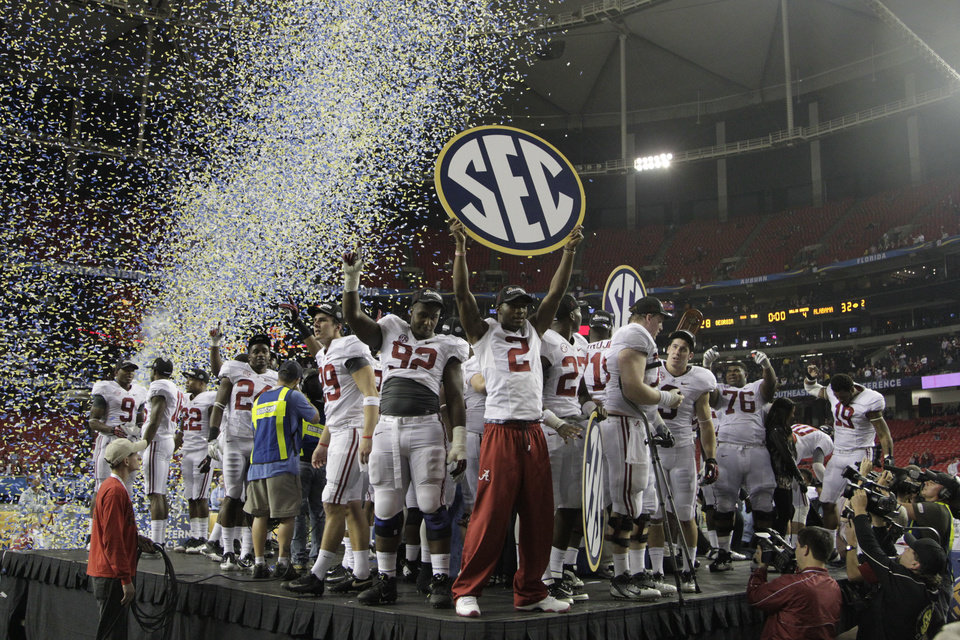 The SEC was the first conference to instutute a conference title game. Though not popular at first, the game has often propelled its winner to the national title game, as it did last year when Alabama, pictured, beat Georgia.AP PHOTO