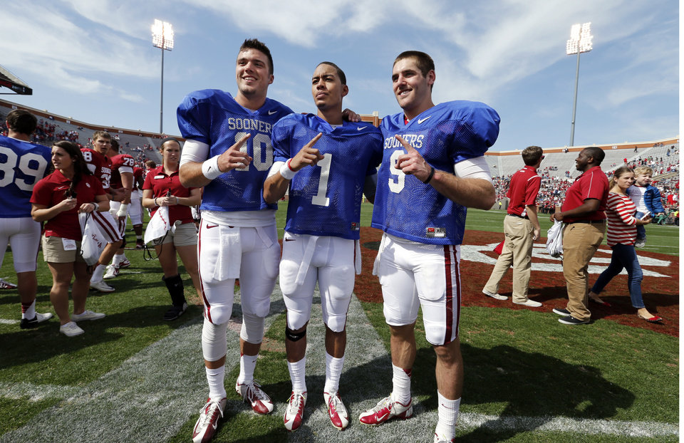 Photo - OU / UNIVERSITY OF OKLAHOMA / COLLEGE FOOTBALL: Quarterbacks Blake Bell (10), Kendal Thompson (1) and Trevor Knight (9) pose for a fan photograph after the annual Spring Football Game at Gaylord Family-Oklahoma Memorial Stadium in Norman, Okla., on Saturday, April 13, 2013. Photo by Steve Sisney, The Oklahoman