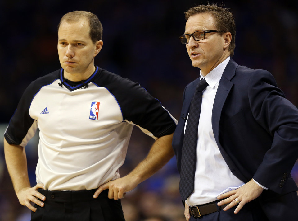 Photo - Oklahoma City head coach Scott Brooks talks with official John Goble during Game 7 in the first round of the NBA playoffs between the Oklahoma City Thunder and the Memphis Grizzlies at Chesapeake Energy Arena in Oklahoma City, Saturday, May 3, 2014. Photo by Nate Billings, The Oklahoman