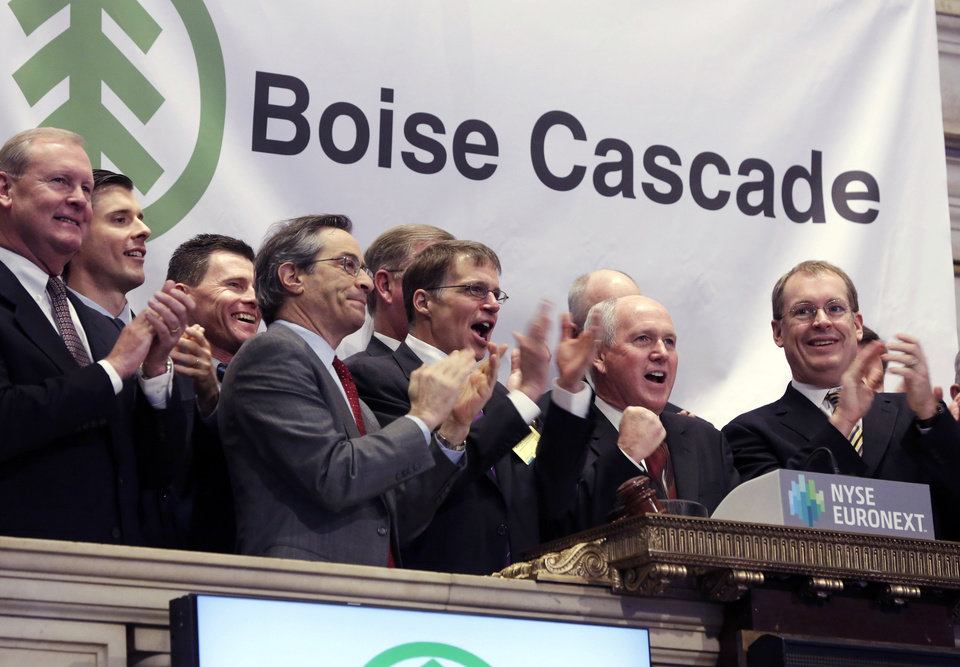 Boise Cascade Chief Executive Officer Thomas Carlile, second from right, joined by members of the companyís executive management team, rings the opening bell of the New York Stock Exchange, to celebrate their IPO, Wednesday, Feb. 6, 2013. Strong earnings reports from media giants Disney and Time Warner aren\'t impressing investors in early trading, and major U.S. market indexes are opening lower. (AP Photo/Richard Drew)