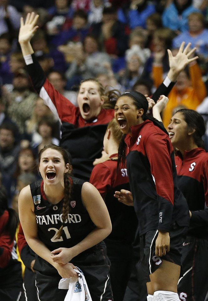 Photo - Stanford players celebrate a three-point shot against Connecticut during the first half of the semifinal game in the Final Four of the NCAA women's college basketball tournament, Sunday, April 6, 2014, in Nashville, Tenn. (AP Photo/John Bazemore)
