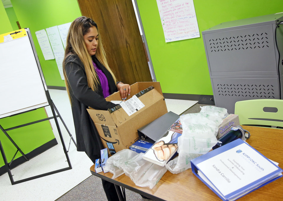 Photo -  Sandra Carrillo, a fourth-grade reading teacher, opens a box of school supplies at KIPP OKC South Community Prep, a new charter school, inside Western Hills Church at 401 SW 44. [Photo by Nate Billings, The Oklahoman]