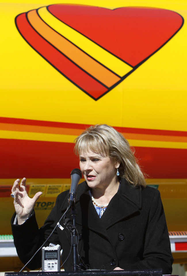 "Gov. Mary Fallin speaks Monday during the opening of Love's Travel Stops first ""fast fill"" CNG facility for heavy-duty trucks at Interstate 40 and Morgan Road in Oklahoma City. Photo By Steve Gooch, The Oklahoman <strong>Steve Gooch</strong>"