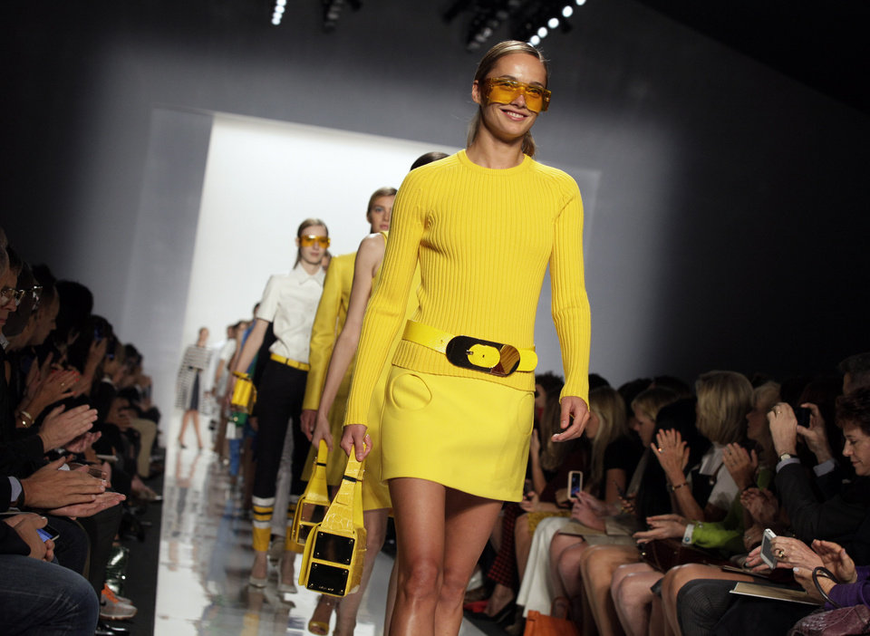 Photo -   Models walk in the finale of the Michael Kors Spring 2013 collection during Fashion Week in New York, Wednesday, Sept. 12, 2012. (AP Photo/Richard Drew)