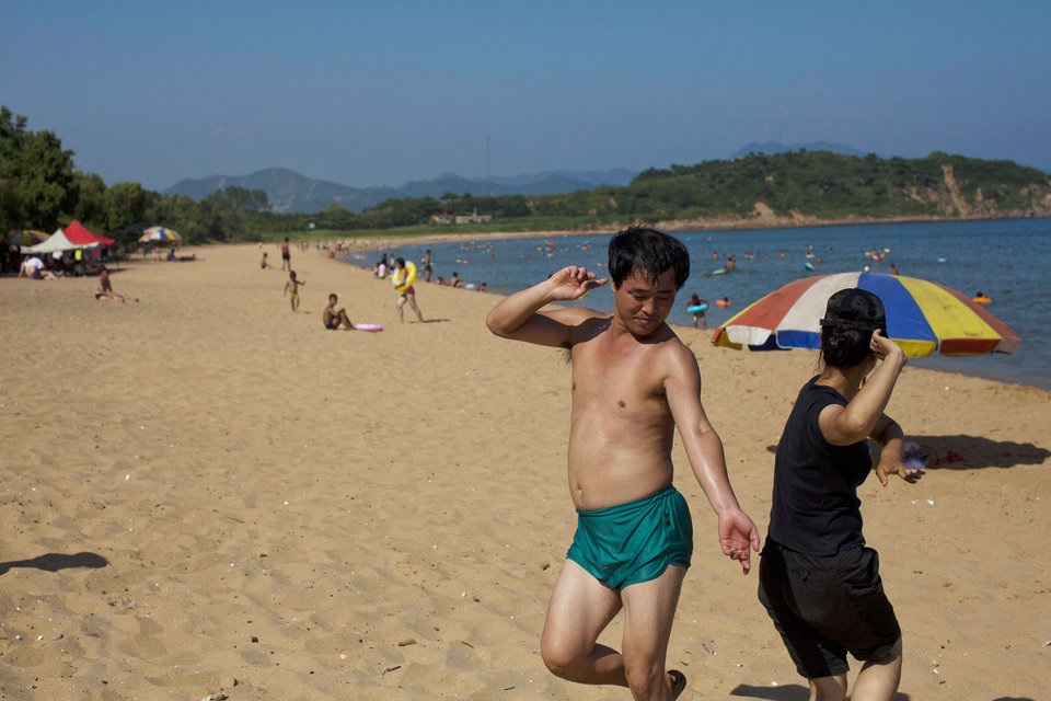 In this Aug. 11, 2012 photo, two people dance at Majon beach near Hamhung, North Korea. (AP Photo/David Guttenfelder)