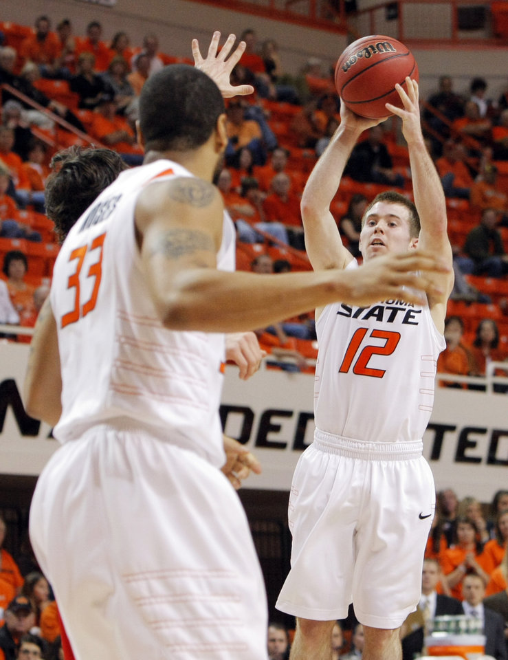 Photo - OSU's Keiton Page (12) passes the ball in the first half during the men's college basketball game between Nicholls State University and Oklahoma State University at Gallagher-Iba Arena in Stillwater, Okla., Saturday, Nov. 21, 2010. Photo by Nate Billings, The Oklahoman