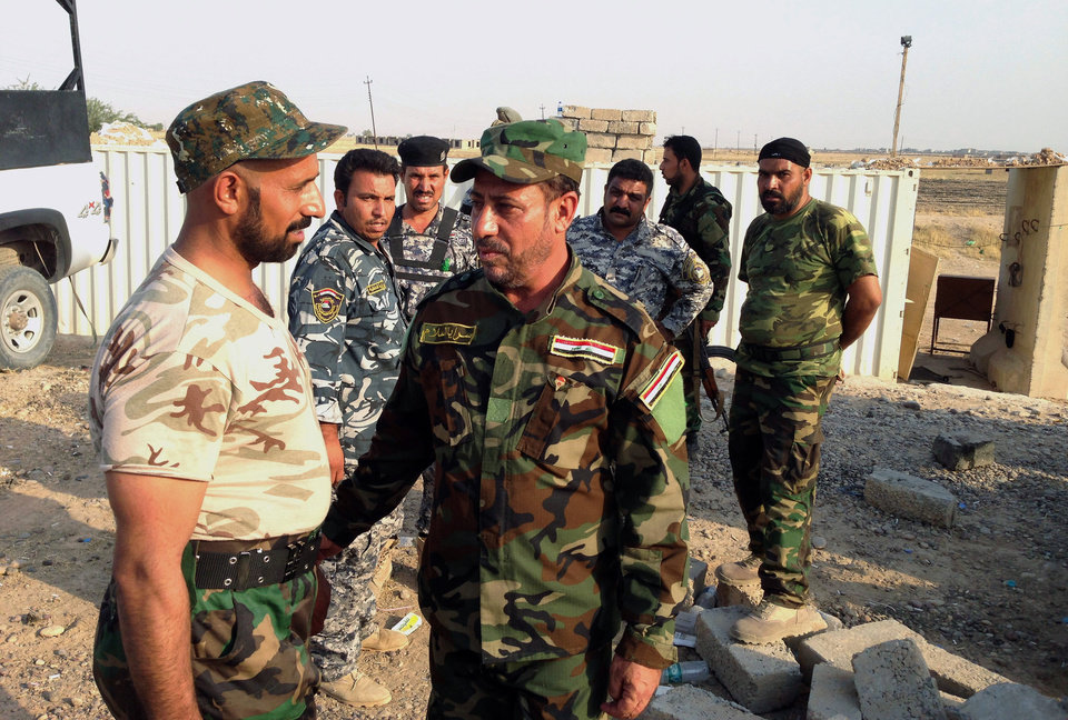 Photo - In this Friday, July 4, 2014 photo, Iraqi lawmaker Hakim al-Zamili, center, visits fighters of