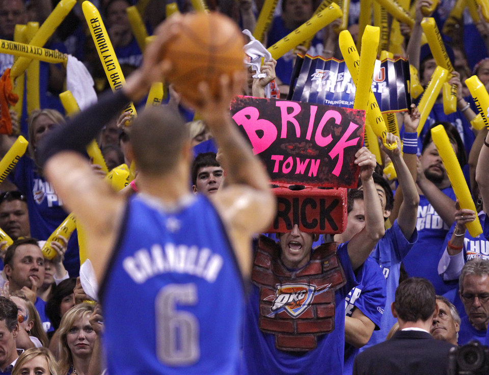 Thunder fans try to rally their team as Tyson Chandler (6) of Dallas shoots a free throw during game 3 of the Western Conference Finals of the NBA basketball playoffs between the Dallas Mavericks and the Oklahoma City Thunder at the OKC Arena in downtown Oklahoma City, Saturday, May 21, 2011. Photo by Chris Landsberger, The Oklahoman