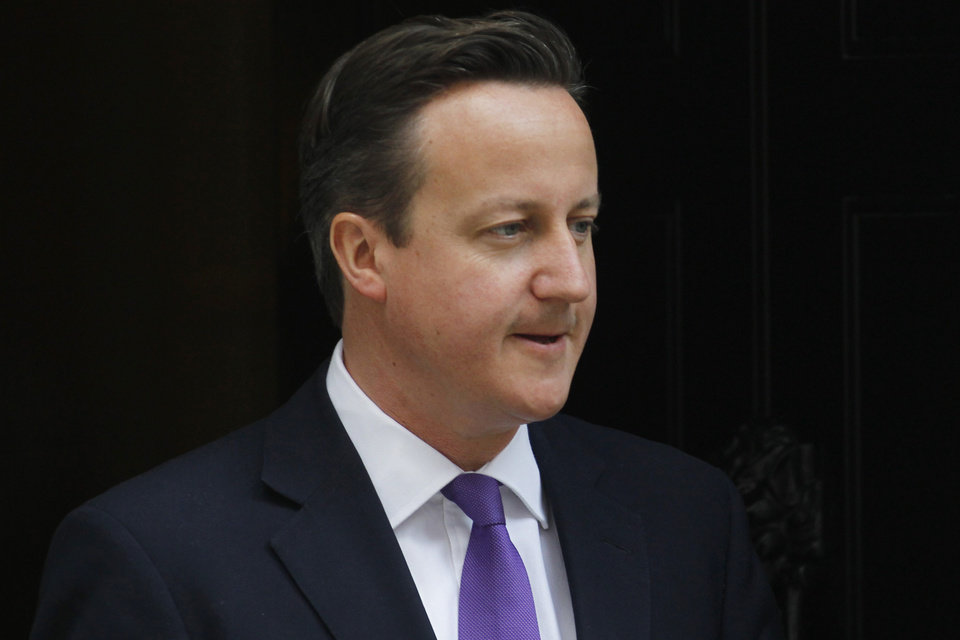 Photo -   British Prime Minister David Cameron leaves 10 Downing Street in London, Thursday, June 14, 2012. Cameron is due to give evidence at the Leveson Inquiry, a judge-led inquiry into media ethics, at the High Court in London on Thursday. (AP Photo/Sang Tan)