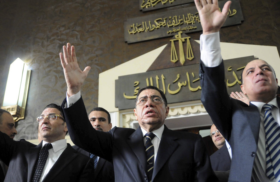FILE - In this Saturday, Oct. 13, 2012 file photo, Egyptian Prosecutor General Abdel-Meguid Mahmoud addresses hundreds of supporters, judges, lawyers and media, not shown, in a downtown courthouse defying a presidential decision to remove him from his post, saying this infringes on the judiciary's independence, in Cairo, Egypt. An Egyptian appeals court on Wednesday, March 27, 2013 annulled a presidential decree appointing the top prosecutor in a new challenge by the judiciary to Islamist President Mohammed Morsi that throws the country�s legal system into confusion. The dispute is rooted in a series of controversial decrees Morsi issued in November that sparked widespread protests. In them, he decreed that the prosecutor general could serve in office for only four years, with immediate effect on the post�s holder at the time Abdel-Meguid Mahmoud, in place since 2006. (AP Photo/Mohmmed Asad, File)