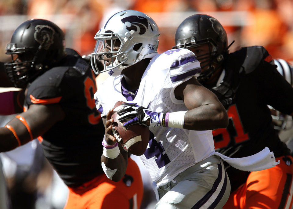 Kansas State's Daniel Sams (4) scrambles  during a college football game between the Oklahoma State University Cowboys (OSU) and the Kansas State University Wildcats (KSU) at Boone Pickens Stadium in Stillwater, Okla., Saturday, Oct. 5, 2013. Photo by Sarah Phipps, The Oklahoman