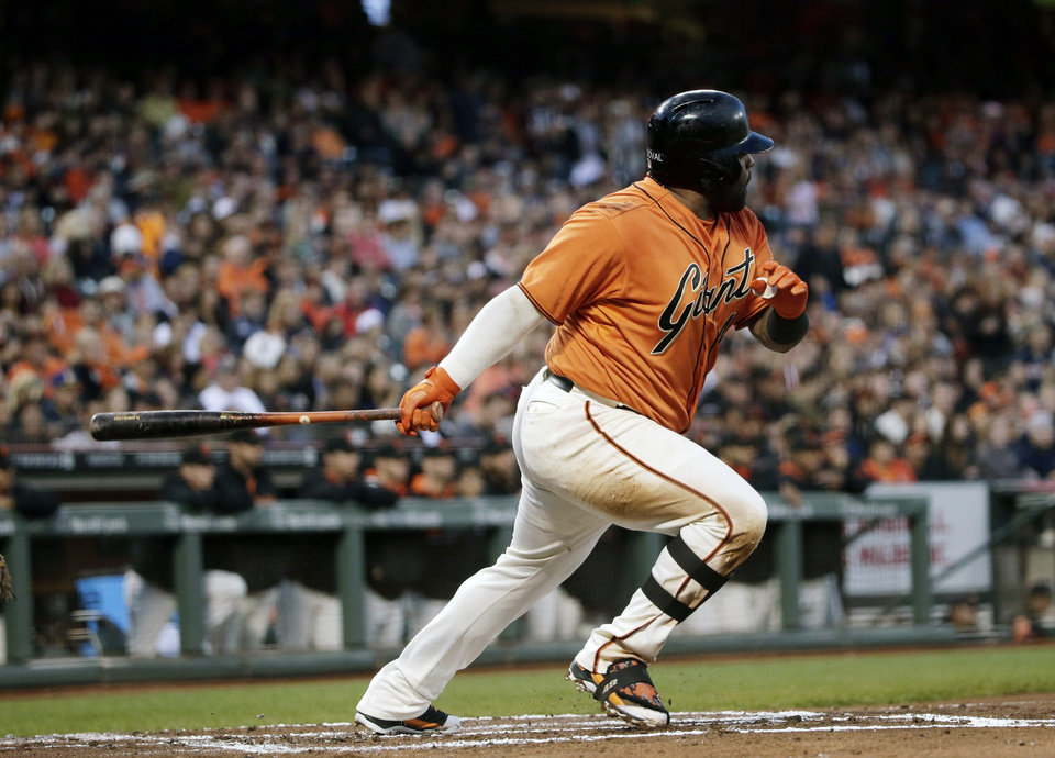 Photo - San Francisco Giants' Pablo Sandoval drives is in a run with a single against the Milwaukee Brewers during the first inning of a baseball game on Friday, Aug. 29, 2014, in San Francisco. (AP Photo/Marcio Jose Sanchez)