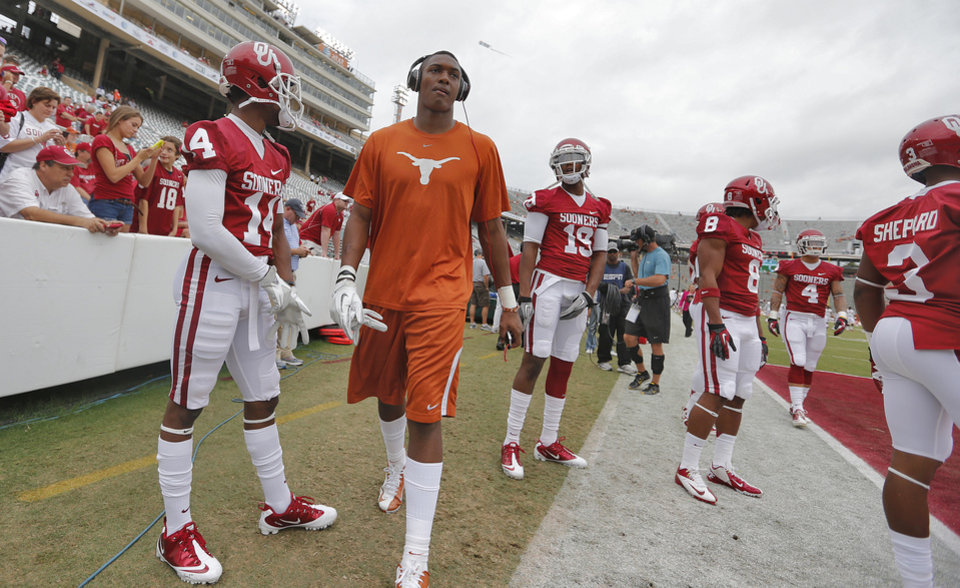 A Texas player walks through the middle of the Sooner receiving core warm ups during the Red River Rivalry college football game between the University of Oklahoma (OU) and the University of Texas (UT) at the Cotton Bowl in Dallas, Saturday, Oct. 13, 2012. Photo by Chris Landsberger, The Oklahoman