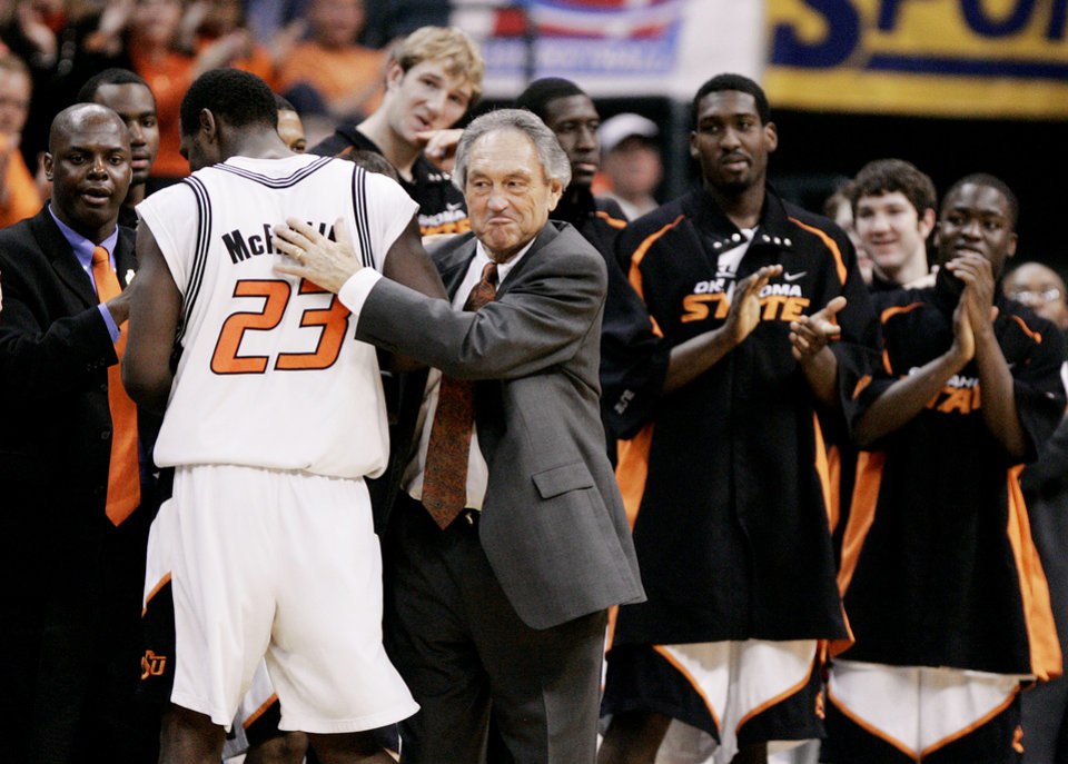 Photo - Oklahoma State University (OSU) Cowboys head coach Eddie Sutton smiles as he hugs Ivan McFarlin (23) after McFarlin led the Cowboys with 31 points to beat Southern Illinois 85-77 in the second round of the NCAA Tournament at the Ford Center in Oklahoma City, March 20, 2005.  By Bryan Terry/The Oklahoman.