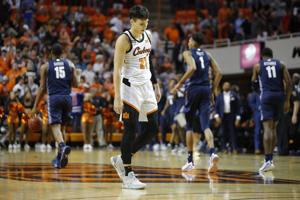 Photo - Oklahoma State's Lindy Waters III (21) walks off the court after a college basketball game between the Oklahoma State University Cowboys (OSU) and the Georgetown Hoyas at Gallagher-Iba Arena in Stillwater, Okla., Wednesday, Dec. 4, 2019. Georgetown won 84-71. [Bryan Terry/The Oklahoman]