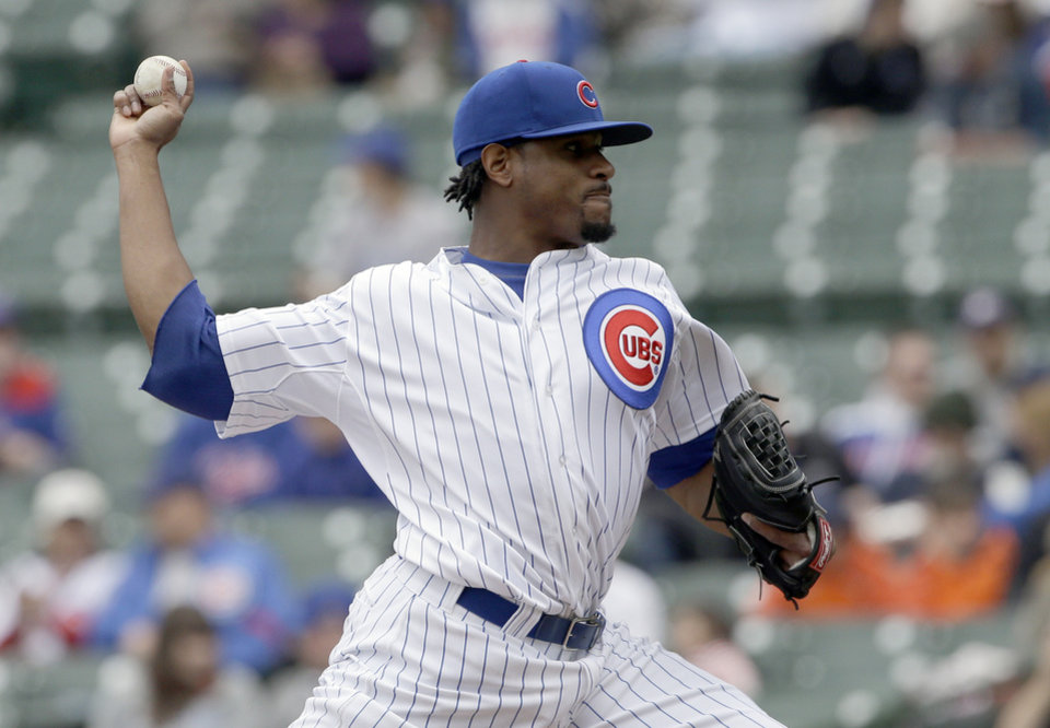 Photo - Chicago Cubs starter Edwin Jackson throws against the Arizona Diamondbacks during the first inning of a baseball game in Chicago, Thursday, April 24, 2014. (AP Photo/Nam Y. Huh)