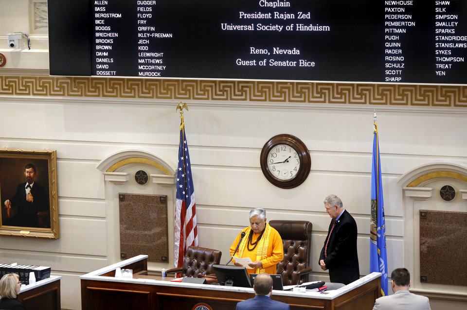 Photo -  Hindu statesman Rajan Zed delivers the invocation in Senate Chambers as Sen. Gary Stanislawski, R-Tulsa, looks on Monday at the state Capitol. [Photo by Jim Beckel, The Oklahoman]