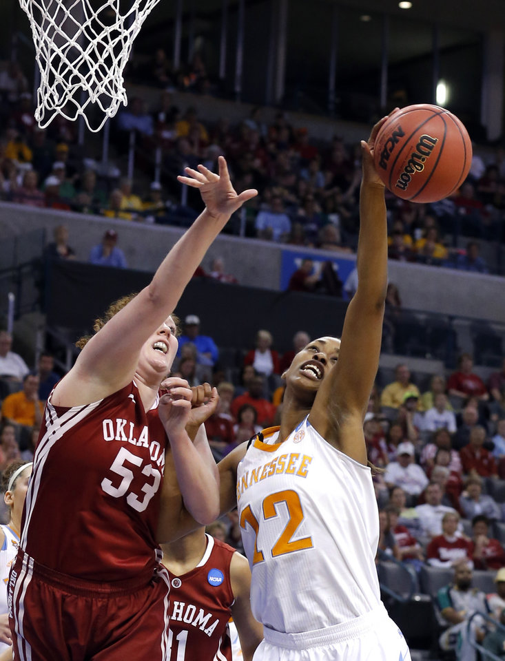 Tennessee\'s Bashaara Graves (12) grabs a rebound from Oklahoma\'s Joanna McFarland (53) during college basketball game between the University of Oklahoma and the University of Tennessee at the Oklahoma City Regional for the NCAA women\'s college basketball tournament at Chesapeake Energy Arena in Oklahoma City, Sunday, March 31, 2013. Photo by Sarah Phipps, The Oklahoman