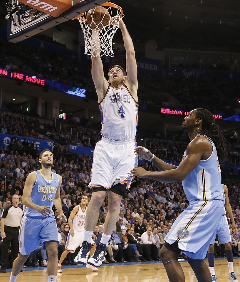 Photo - Oklahoma City's Nick Collison (4) dunks the ball in front of Denver's Evan Fournier (94) and Kenneth Faried (35) during the NBA basketball game between the Oklahoma City Thunder and the Denver Nuggets at the Chesapeake Energy Arena on Wednesday, Jan. 16, 2013, in Oklahoma City, Okla.  Photo by Chris Landsberger, The Oklahoman
