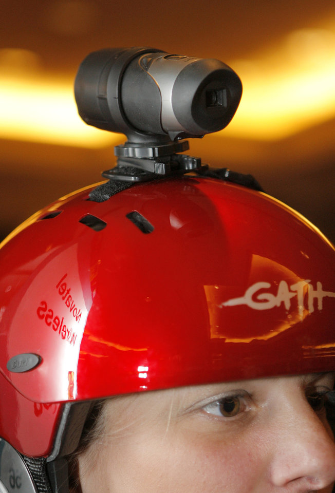 Photo - FILE - In this Saturday, Jan. 5, 2008 file photo, Oregon Scientific's ATC 2K Action Cam, a waterproof hands-free video recorder, is mounted on a helmet at the CES Unveiled press preview event held at the Venetian hotel and casino in Las Vegas. For adventure athletes, it's the new essential: a video of their exploits. Now only video action will do for a shoot-it-and-share-it generation of skiers and skydivers, snowboarders and bike riders. (AP Photo/Jae C. Hong, File)