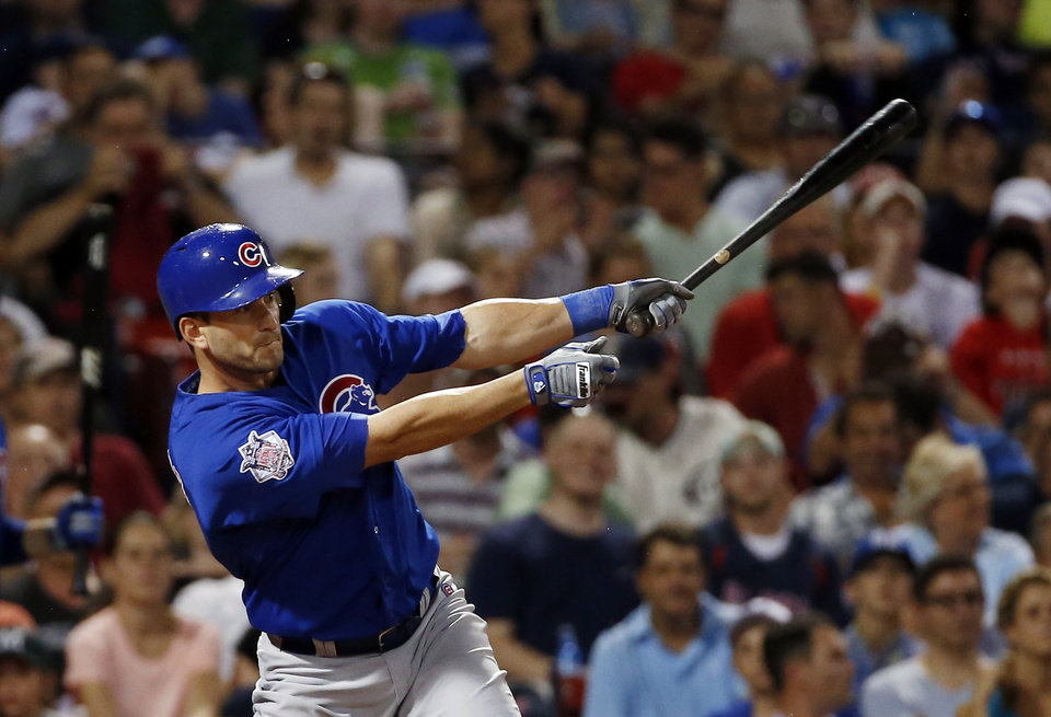 Photo - Chicago Cubs' Justin Ruggiano hits an RBI-single in the sixth inning of a baseball game against the Boston Red Sox at Fenway Park in Boston, Wednesday, July 2, 2014. (AP Photo/Elise Amendola)