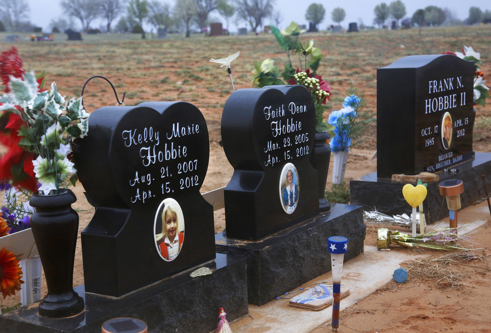 Photo - Tornado victims Frank Hobbie II and his daughters, Kelly Marie and Faith Dean, are buried in the Elmwood Cemetery in Woodward. Photos by Jim Beckel, The Oklahoman