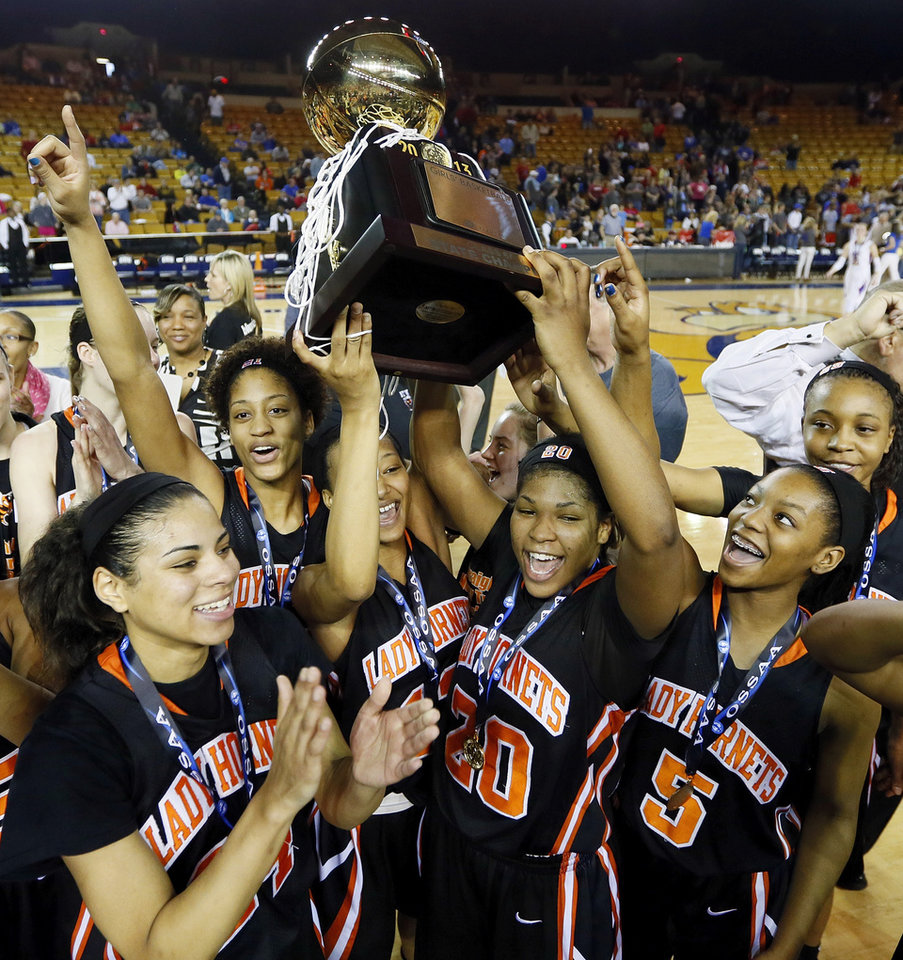 The Booker T. Washington Hornets celebrate with the gold ball after the Class 6A girls championship high school basketball game in the state tournament at the Mabee Center in Tulsa, Okla., Saturday, March 9, 2013. Booker T. Washington beat Bixby, 52-46. Photo by Nate Billings, The Oklahoman