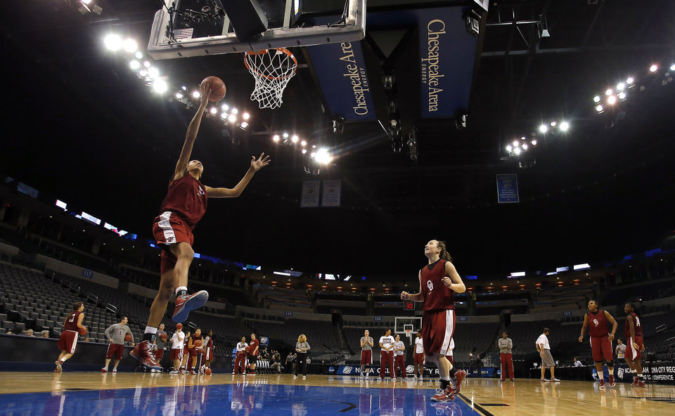Photo - Oklahoma center Nicole Griffin (4) shoots a lay up during the press conference and practice day at the Oklahoma City Regional for the NCAA women's college basketball tournament at Chesapeake Arena in Oklahoma City, Saturday, March 30, 2013. Photo by Sarah Phipps, The Oklahoman