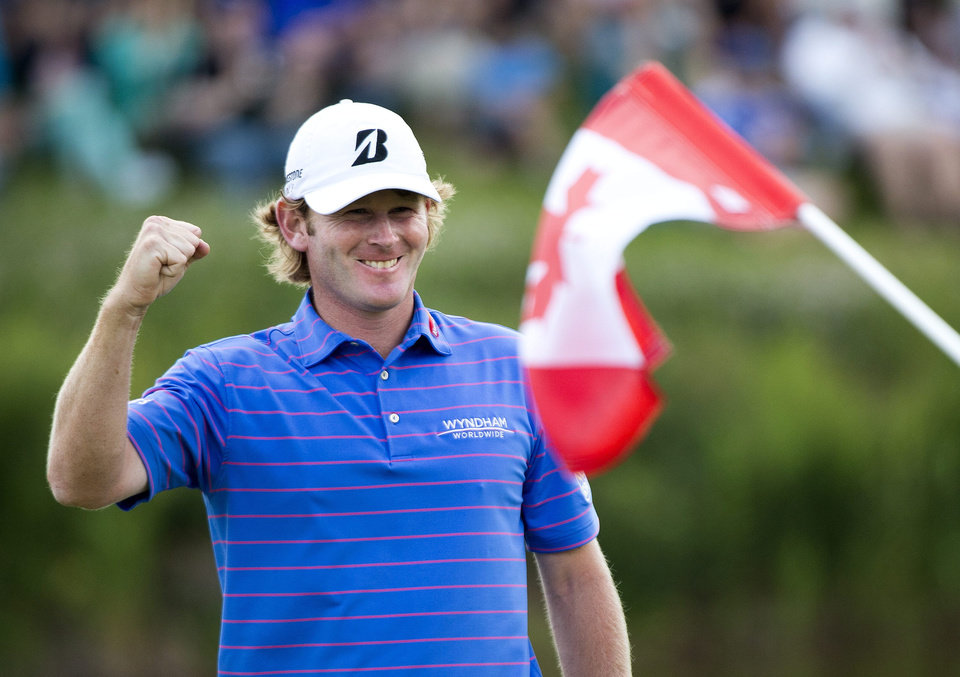 Photo - Brandt Snedeker, right, of the United States, celebrates after winning the Canadian Open golf tournament at Glen Abbey in Oakville, Ontario, Sunday, July 28, 2013. (AP Photo/The Canadian Press, Nathan Denette)
