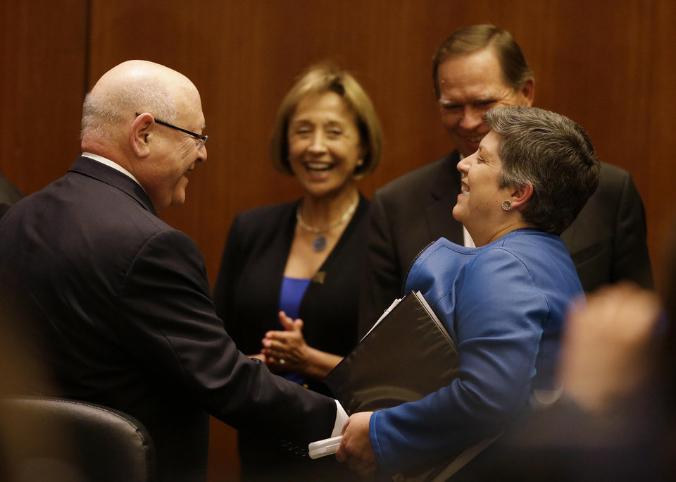 Photo - Homeland Security Secretary Janet Napolitano, right, laughs with University of California president Mark Yudof, left, following a University of California Board of Regents meeting Thursday, July 18, 2013 in San Francisco. The University of California's governing board voted Napolitano to become the system's first female president, but her selection is being criticized by students upset about federal immigration policy and professors concerned about her lack of experience in academia. (AP Photo/Eric Risberg)